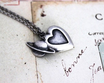 planet. heart locket necklace. in silver ox jewelry