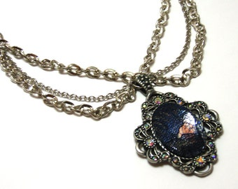 Blue Lace Cameo Necklace - Navy blue lace over a rhinestone cameo set in silver with iridescent finish rhinestone accents and silver chain