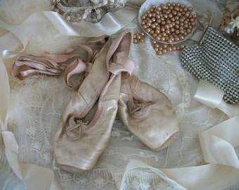 vintage satin ballet pointe toe shoes, well worn, shabby faded aged pink color, timeworn, professional dance, satin ribbons, chic color