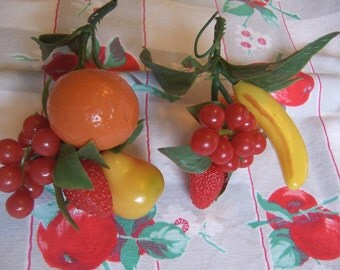 two plastic fruit sprigs