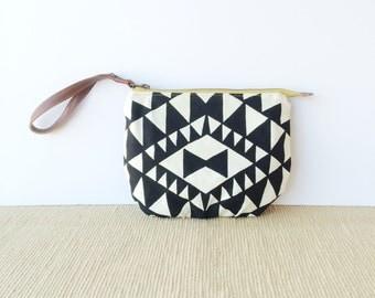 wristlet clutch • gifts under 50 - wrist strap • black and white - hand screenprinted geometric print - waxed canvas - zipper pouch • vukani