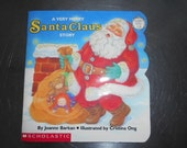 A Very Merry Santa Claus Story book Sparkles and Glows in the Dark