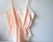 Wedding vintage 80s pastel pink , shiny polyester teddy with a white lace, flowers embroidery. Made by Barbizon. Size M.
