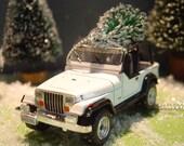 Jeep Wrangler car with Christmas tree ornament