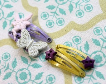 4 baby yellow purple snap clips,fairy,butterfly,stars,fairy snap clip,butterfly snap clip,star snap clips,baby snap clips,yellow snap clip