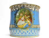 beautiful shabby english tea or biscuit tin . romantic and rose scene on baby aqua background . Daher style tin