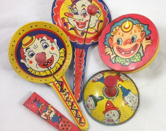 Collection of Five Vintage, Tin, Noise Makers with Clowns