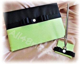 Neon green and black wedding guest book and pen set.
