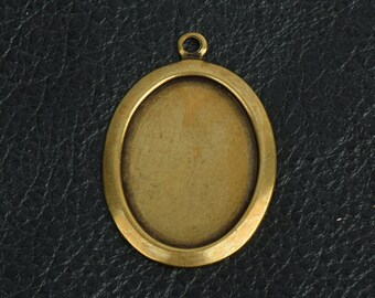 Oval metal bezel setting or stamping area, brass and antiqued sold by 6 each 15274BR