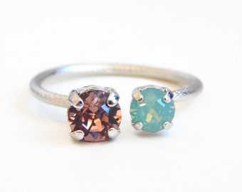Adjustable double snake ring made with pacific opal and blush Swarovski Crystals