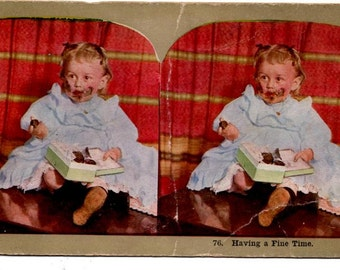 Antique Stereo View Card Toddler Girl Eating Box of Chocolates Having A Fine Time Stereoscope Photo