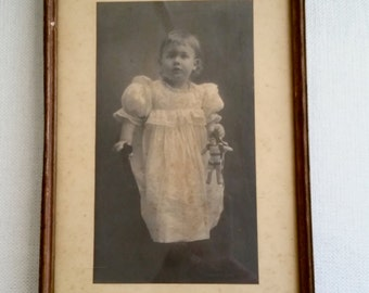 Antique Photo in original antique frame, small child with toy