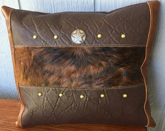 Hair on cowhide fur inset and leather pillow with star concho and studs