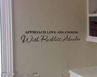 Approach love and cooking with reckless abandon- great kitchen wall quote