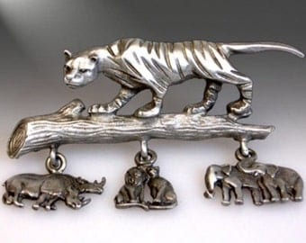 Vintage L Razza jungle animals lions tigers rhinos elephants pewter brooch