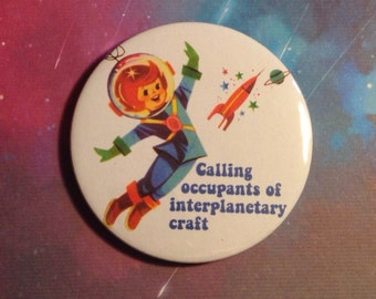 Vintage mash-up pin badge - Calling Occupants of Interplanetary Craft (The Carpenters)