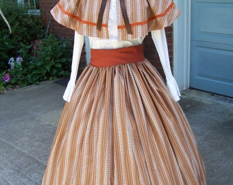 Colonial,Civil War,Victorian, Long SKIRT,Sash and cape one size fits all Brown, Blue and beige stripe colonial print with rust sash.
