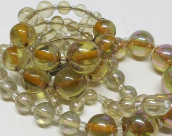 A Matching Necklace and Bracelet In Opalescent Pale Yellow