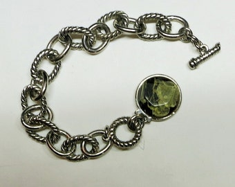 A Chain Link Bracelet with a Glass Stone Charm