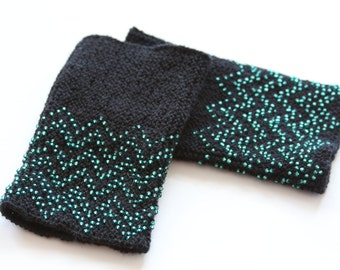 Black traditional Lithuanian hand knitted wrist warmers with beaded in green glass beads, wavy pattern