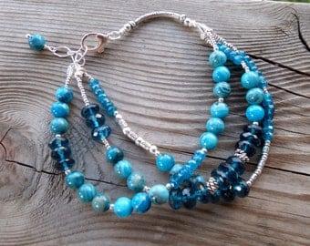 London Blue Topaz, Crazy Blue Lace Agate, and Dark Blue Apatite Fine Silver Triple Strand Gemstone Bracelet