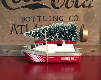 Boat Carrying Christmas Tree Ornament