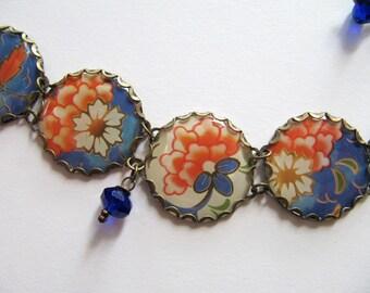 Vintage Tin Charm Bracelet in White and Blue with Orange Flowers, Sapphire Blue Glass Beads - OOAK Handmade Bracelet, Repurposed Jewlery