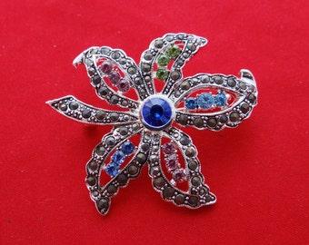 """20% off sale Vintage silver tone 2"""" star with multicolored rhinestones brooch in unworn condition"""