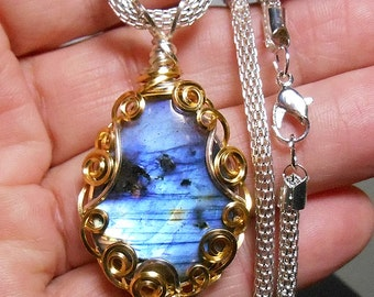 Scenic labradorite  pendant,  bright well centered  flash,  hand wrapped, silver and gold tone  filigree setting