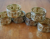 six gold tone round filagree napkin rings - hollywood regency - traditional