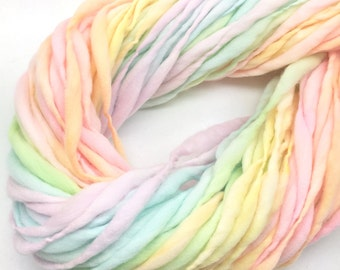 Self striping pastel rainbow yarn handspun thick and thin in merino wool - 58 yards, 3.5 ounces/ 100 grams