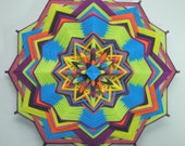 The Source, a 24 inch, Ojo de Dios, in stock by Janelle Lucido-Conate