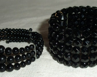 Two Black Beaded Cuff Bracelets.