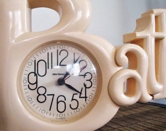 "1970s Ivory Plastic Battery Operated ""Bath"" Wall Clock"