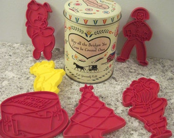 Pennsylvania Dutch Tin and 6 vintage Plastic Cookie Cutters