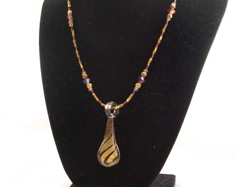 Handmade purple and gold glass beaded necklace