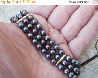 ON SALE Triple strand black pearl bracelet in 14kt.