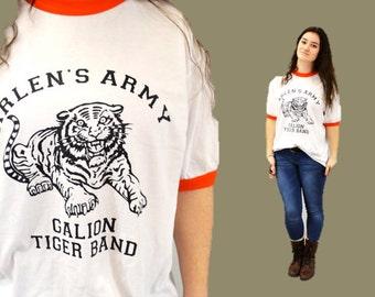 Graphic tshirt vintage hipster indie t-shirt retro band music arlens army white ringer tee oversized orange  random tee IngridIceland