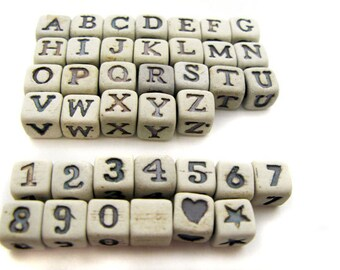 10 Tiny high-fired Letter beads -