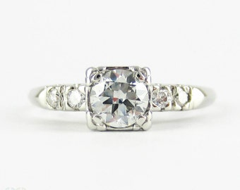 Vintage Transitional Cut Diamond Engagement Ring, Platinum Set Diamond Ring. 0.64 ctw. Circa 1930s.
