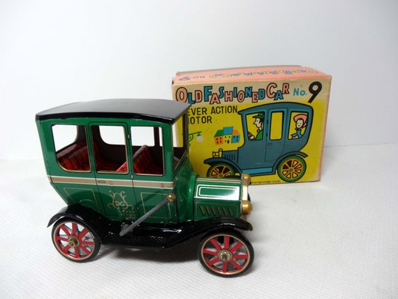 Old Time Toys And Games : Old fashioned car mib green with red interior lever action