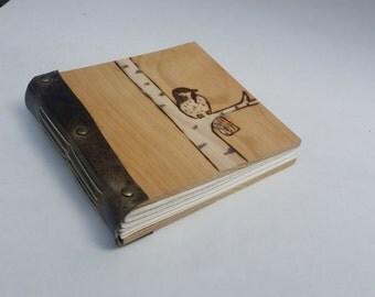 Sketchbook with handpainted bird woodburning
