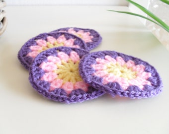 Four Crochet Coasters Yellow Pink Mauve Purple