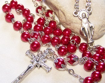 Catholic rosary handmade with red pearls in silver