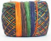 Orange, brown, green, navy self-striping sock yarn   Round Table Yarns Merlin in Deeds of Arms