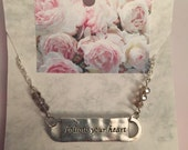 Silver and crystal follow your heart necklace on a pretty peony card