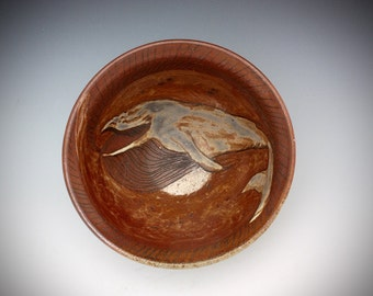Wood fired ceramic hand thrown bowl with whale carving soda fired