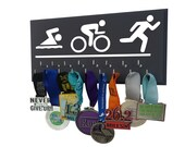 Triathlon: Triathlon medal HOLDER, olympic tri logo, swim. bike. run