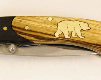 Rough Rider knife with Zebra wood handle and Custom maple bear inlay