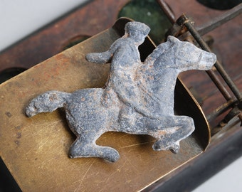 Vintage lead toy, figurine man riding a horse. Horseman